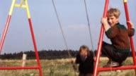 Children on swing (vintage 8mm film) video