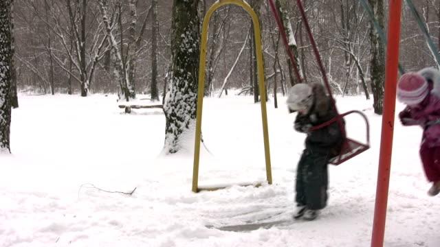 children on winter seesaw video