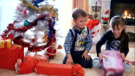 Children opening their Christmas gifts video