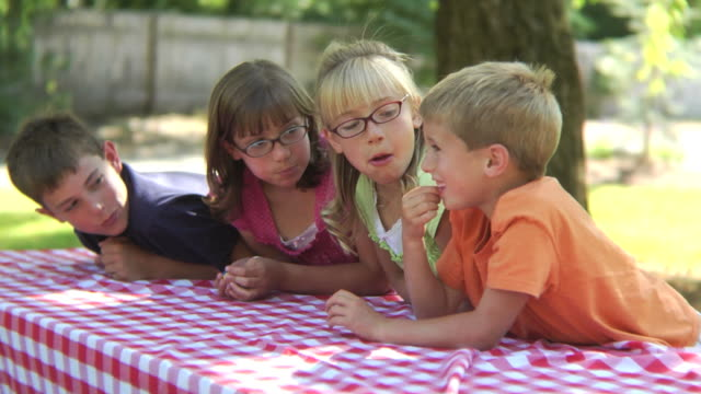 Children outdoors chewing gum video