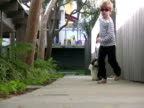 Children & Pets; Running Dog Past Camera video