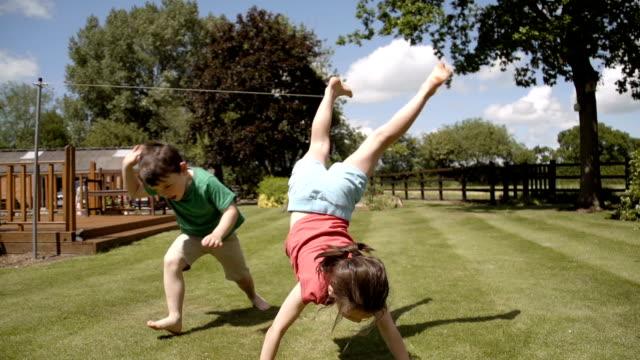 Children Playing Acrobats In the Garden video