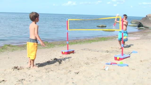 Children playing beach game video