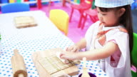 Children playing cooking toy video