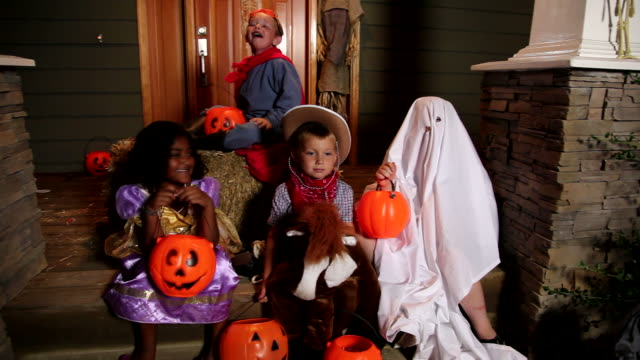 Children playing in Halloween costumes video