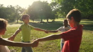 Children playing in park, happy young people, kids, friends video