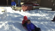 Children playing in the snow during winter video
