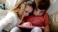 Children Playing on a Digital Tablet video