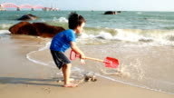 Children playing on the beach video