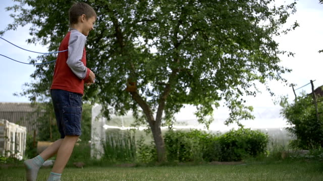 children playing outdoors in the garden, slow motion video