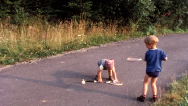 Children playing shuttlecock video