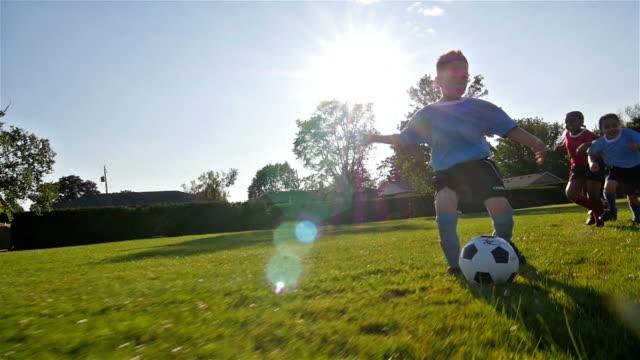 Children playing soccer video