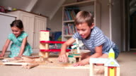 Children Playing With Toys In Bedroom video
