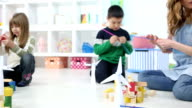 HD: Children Playing With Wind Turbine and blocks. video