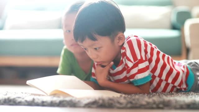 children reading a book video