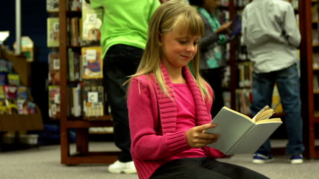 Children reading in Library video