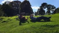 Children Rolling Down A Grass Hill video