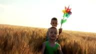 Children running on wheat field video
