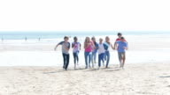 Children Running Towards Camera on Beach video