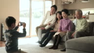 Children taking a family photo with smartphone video