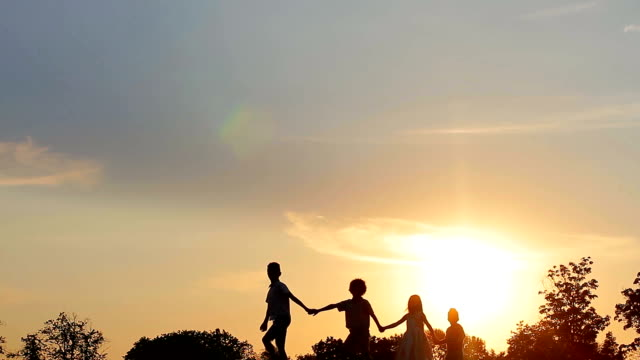 Children walking at sunset. video