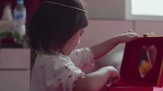 Children Wear Jewelry Of Mother video