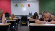Children working at desks video