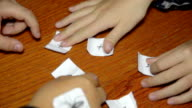 Childrens hands change the paper places with numbers and math symbols on it video