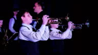 Children's jazz band performs at the theater during a music festival video