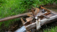 Childrens watermill in a river video