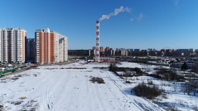 Chimney of power plant and multi-story houses video