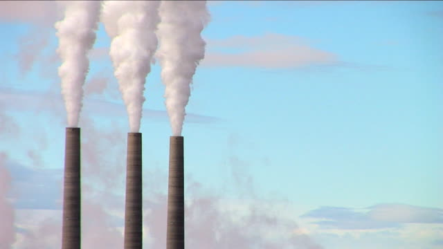 Chimney stacks polluting the atmosphere video