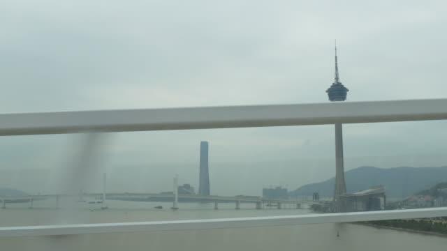 china day time macau road trip backside side bridge tower panorama 4k video