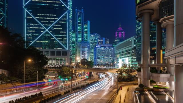 china hong kong city night light traffic street business block 4k time lapse video