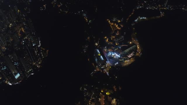 china night illumination hong kong famous bay coastline aerial view 4k video