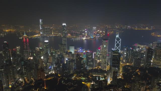 china night light famous hong kong city lantau island bay aerial panorama 4k video