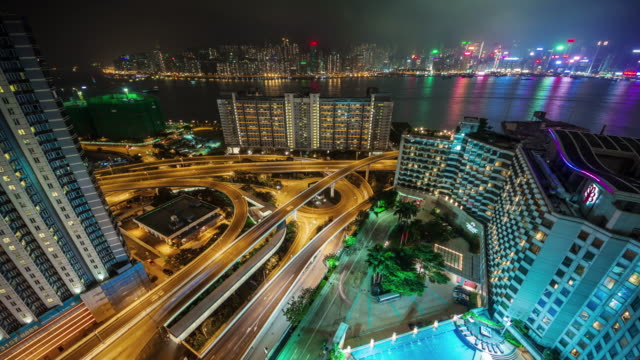 china roof top night light hong kong traffic crossroad junction 4k time lapse video