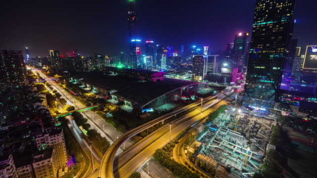 china shenzhen night light traffic crossroad roof top view 4k time lapse video