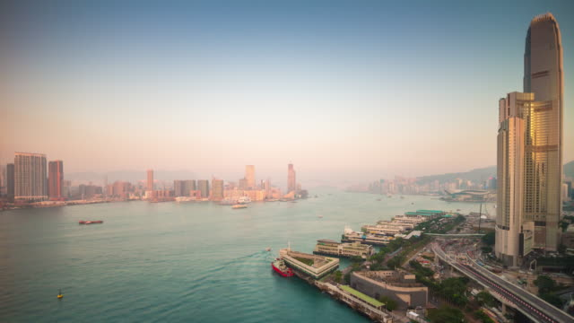 china sunset light hong kong city bay victoria harbour rooftop panorama 4k time lapse video