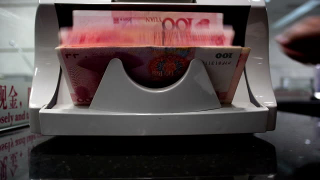 Chinese 100RMB banknotes on a currency counting machine video