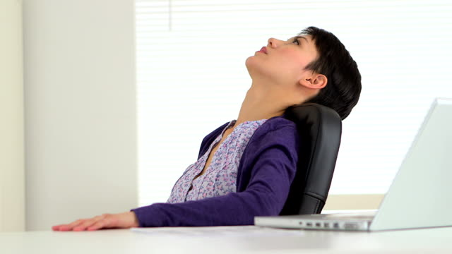 Chinese businesswoman taking a break at work video