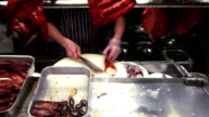 Chinese Chef Slicing Roasted Peking Duck In London Chinatown video