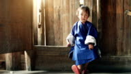 Chinese female child sitting  on the traditional high saddle board video