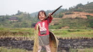 Chinese girl playing with rice during harvest video