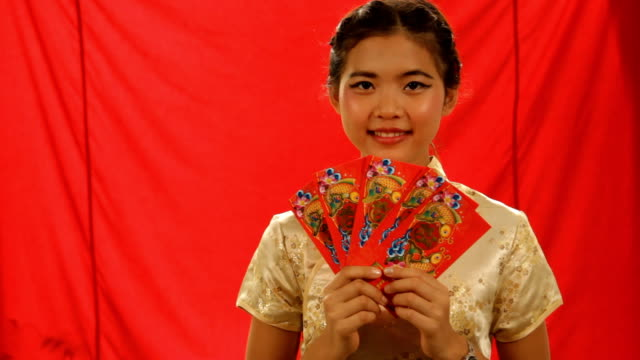 Chinese girls holding red envelopes video