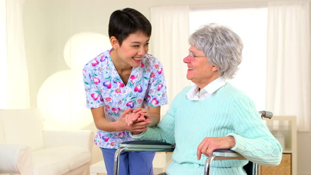 Chinese nurse advising elderly patient video