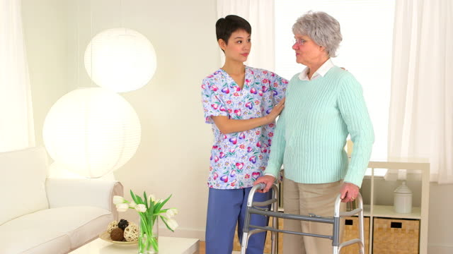 Chinese nurse assisting elderly patient video