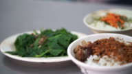 Chinese Taiwanese seafood over rice dish and side dishes video