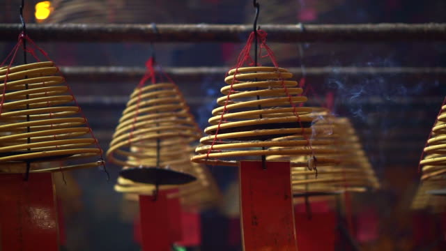 Chinese temple in Hong Kong iconic lanterns and Incense coils video