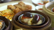 Chinese traditional food, steamed dim sum, yum cha in bamboo tray video